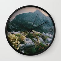 Wall Clocks featuring Mountain flowers at sunrise by Bor Cvetko