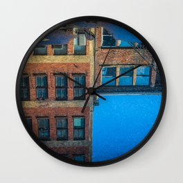 reflections in a puddle in columbus Wall Clock