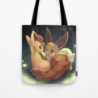 eevee Tote Bags featuring Eevee and Vulpix by Yamilett Pimentel