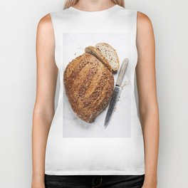 Large loaf of bread on white marble background Biker Tank