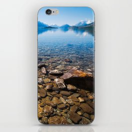 Snow-capped mountains view in summer from the rocky shore of lake Wakatipu. iPhone Skin