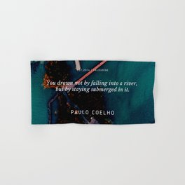 Paulo Coelho Quote |You drown not by falling into a river, but by staying submerged in it. Hand & Bath Towel