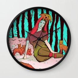 A women's among wolves Wall Clock