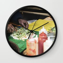 Hand rolling healthy vegetarian wrap with spinach Wall Clock