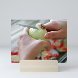 Cutting an onion Mini Art Print