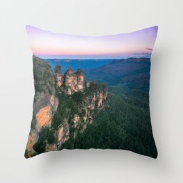 Cold morning but warm sunrise colors in the sky at Three Sisters in Blue Mountains. Throw Pillow