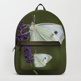 Butterfly on lavender, green blurry background Backpack