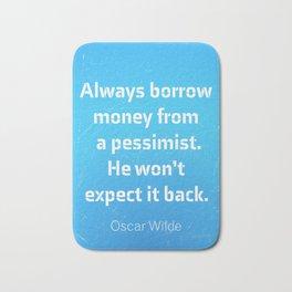 """Always borrow money from a pessimist. He won't expect it back."" Oscar Wilde Bath Mat"
