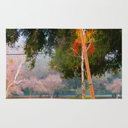 Green pastures and trees photo Rug