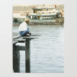 Birmese man sitting on a pier on the Yangon River, Myanmar Poster