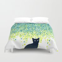 budi Duvet Covers featuring Cat in the garden under willow tree by Picomodi