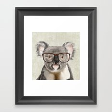 A baby koala with glasses on a rustic background Framed Art Print