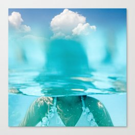 Little girl in water, with clouds Canvas Print