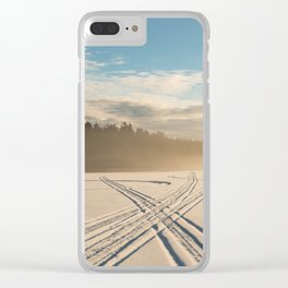 Crossing tracks on snow covered frozen lake Clear iPhone Case