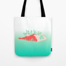 Sinking into the grass Tote Bag
