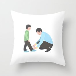 dad tying shoelaces to his son. A man with a little boy. Throw Pillow