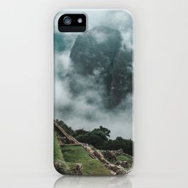 Ancient Inca ruins of Machu Picchu and surrounding Andes mountains on a misty morning iPhone Case