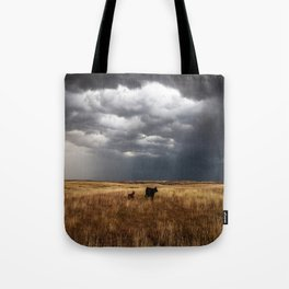 Life on the Plains - Cow Watches Over Playful Calf in Oklahoma Tote Bag