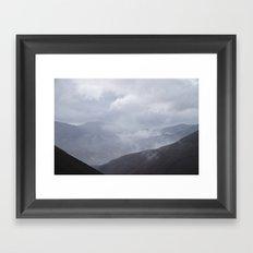 Rain clouds rolling through the mountains. Cumbria, UK. Framed Art Print