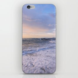 Golden hour with a lighthouse in the beach iPhone Skin