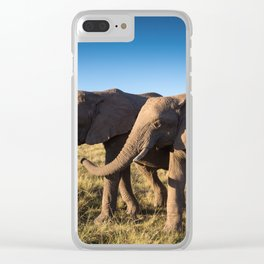 Two happy elephants walking together in African Savannah at sunset Clear iPhone Case