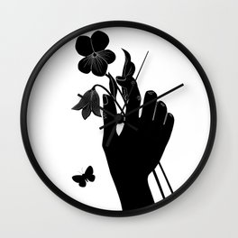 Black Hand Holding Flowers Wall Clock