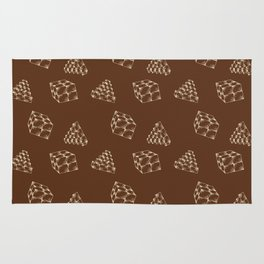 the pyramids and cubes on a brown background . artwork Rug