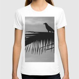 Bird silhouette with palm tree leaf in the Caribbean T-shirt