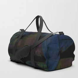 A pile of feathers of the Magpie Duffle Bag