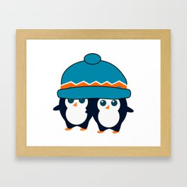 When two cute penguins find a beanie Framed Art Print