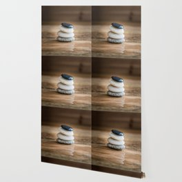 Pile of small wet pebbles on rustic wood front view Wallpaper