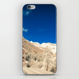 Sunny day in the alps after the snowfall iPhone Skin