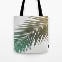 palm tree Tote Bags featuring palm tree by iulia pironea