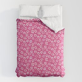 Loose pink flowers in hot pink background Comforters