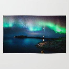 Aurora Borealis Over Coastal Waters Rug