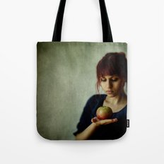 the girl with the apple Tote Bag