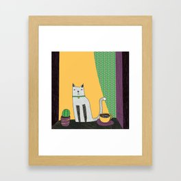 Cat at the window Framed Art Print