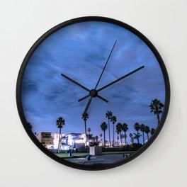 Nighttime in a beach town Wall Clock