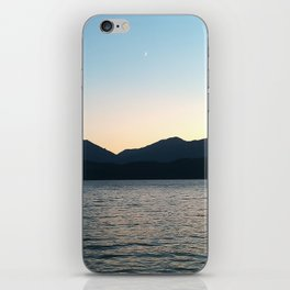 Sunset and Crescent Moon over the Water iPhone Skin