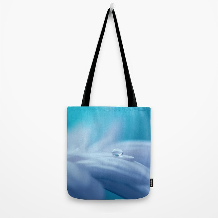 Lonely droplet on a daisy in blue  on #Society6 Tote Bag