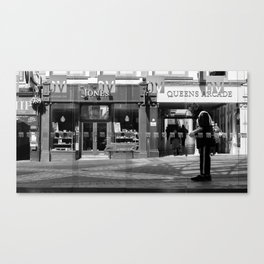 A paperboy outside an arcade in Leeds Canvas Print