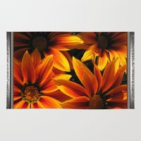 jem Area & Throw Rugs featuring Gazania named Kiss Orange Flame by JMcCombie