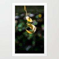 Yellow leaves in colorful bokeh Art Print