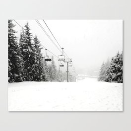 Lifts waiting for action in the snow Canvas Print