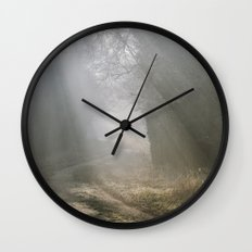 Sunlight through mist along a remote country track. Norfolk, UK. Wall Clock