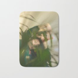 Blurred woman and man behind plants, dancers, romance Bath Mat
