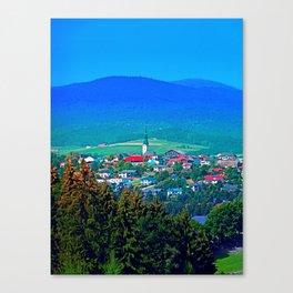 Village below the mountains Canvas Print