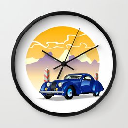 Blue retro car on a mountain landscape Wall Clock