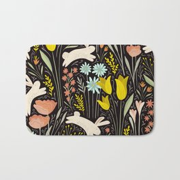 Bunnies in the garden Bath Mat
