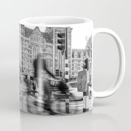 Cyclists ride in Amsterdam street in front of the Rijksmuseum Coffee Mug